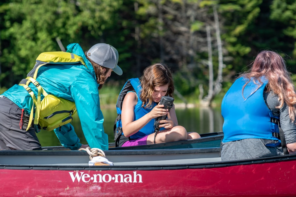 A girl studies a water sample meter