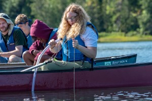 A girl performs a water quality test in Heart Lake