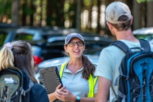 HPIC parking lot attendant speaking to hikers