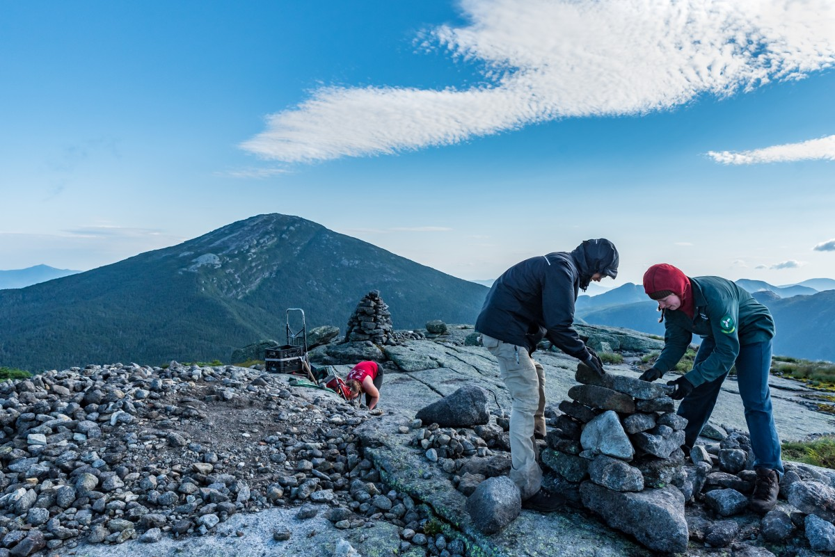 A wide angle view of the trail crew working on the summit of Skylight as they build cairns