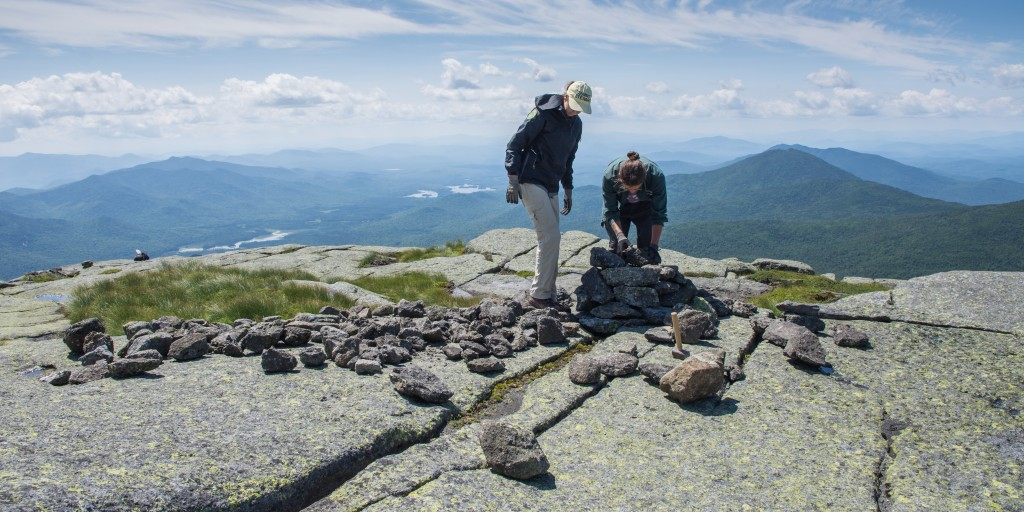 2 people building a cairn