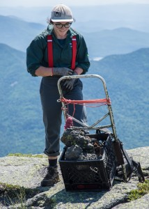 A woman dumped a load of rock on a summit