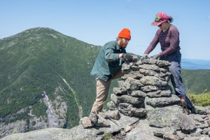 Trails crew building a cairn