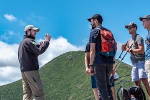 Summit Steward Tom talks to Hikers