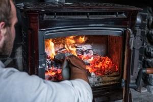 A man stokes a fire