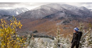 Woman loverlooks autumn mountain vista