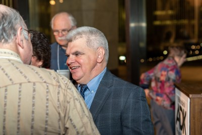 Neil Woodworth smiles while being congratulated