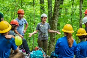 Two Leave No Trace Traveling Trainers speak to a group of trail workers