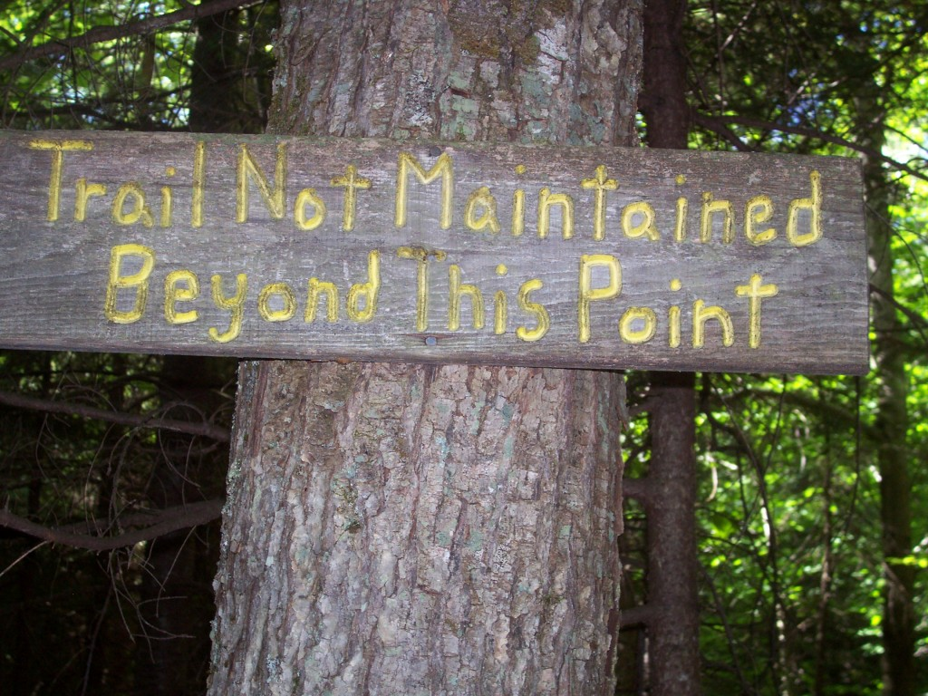 """A sign that says """"trail not maintained beyond this point"""""""