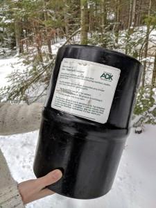 A black Garcia bear canister