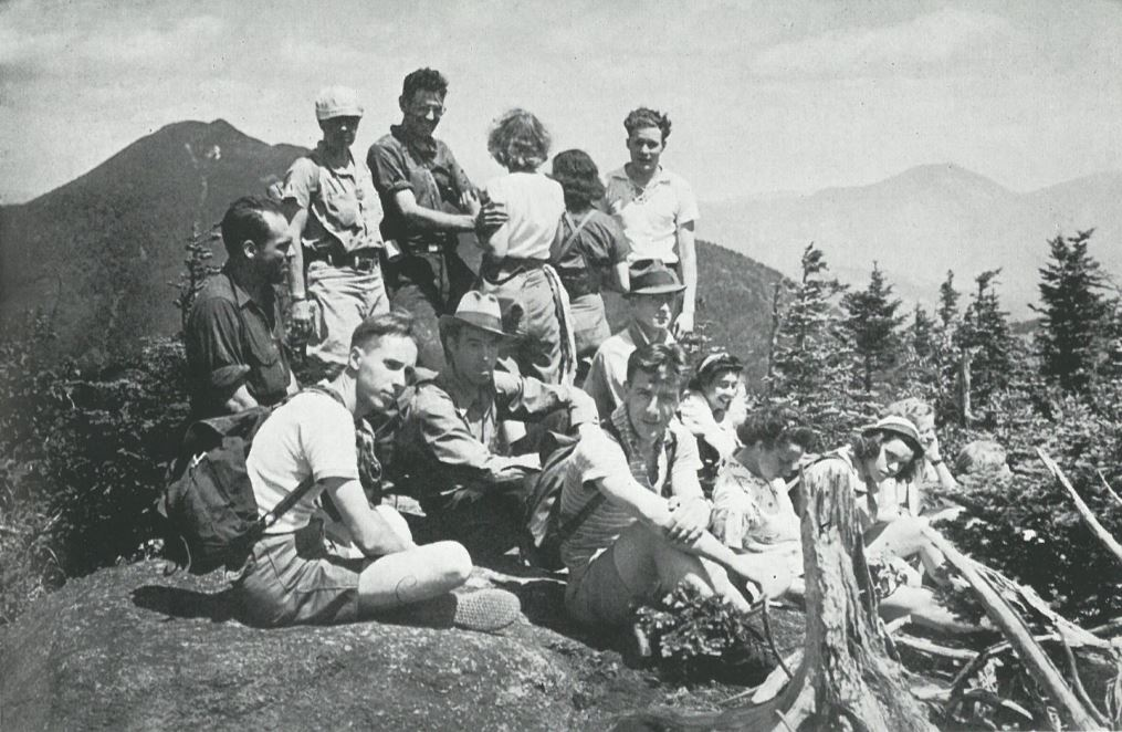 A group of people sitting on a summit