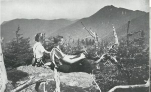 Two people on a summit looking into the distance