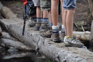A row of feet on a bridge