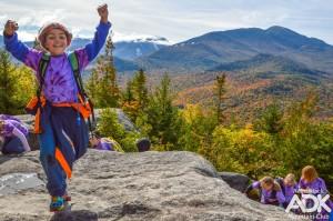A child walks on a rocky summit