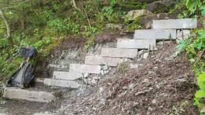 A rock staircase with a backpack