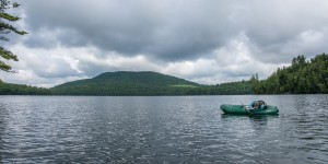 A woman floats on a lake in a raft