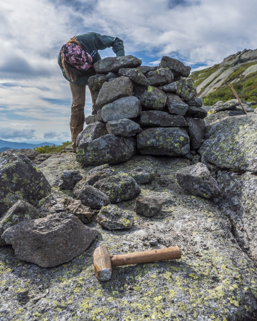 A woman building a cairn