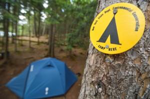 A tent symbol with a tent
