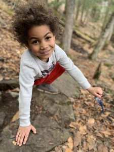 A boy climbing on rocks