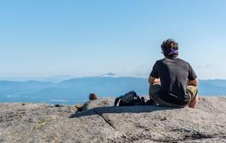 A man sitting on a summit