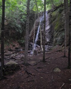 A waterfall in a wooded setting