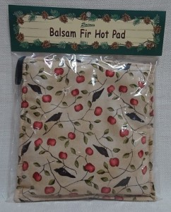 Balsam hot pad with apple and crow design
