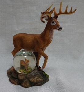 Image of deer with snow globe