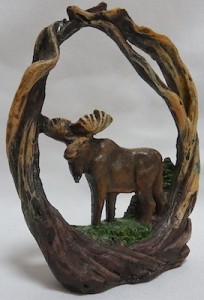 Moose figurine in branches