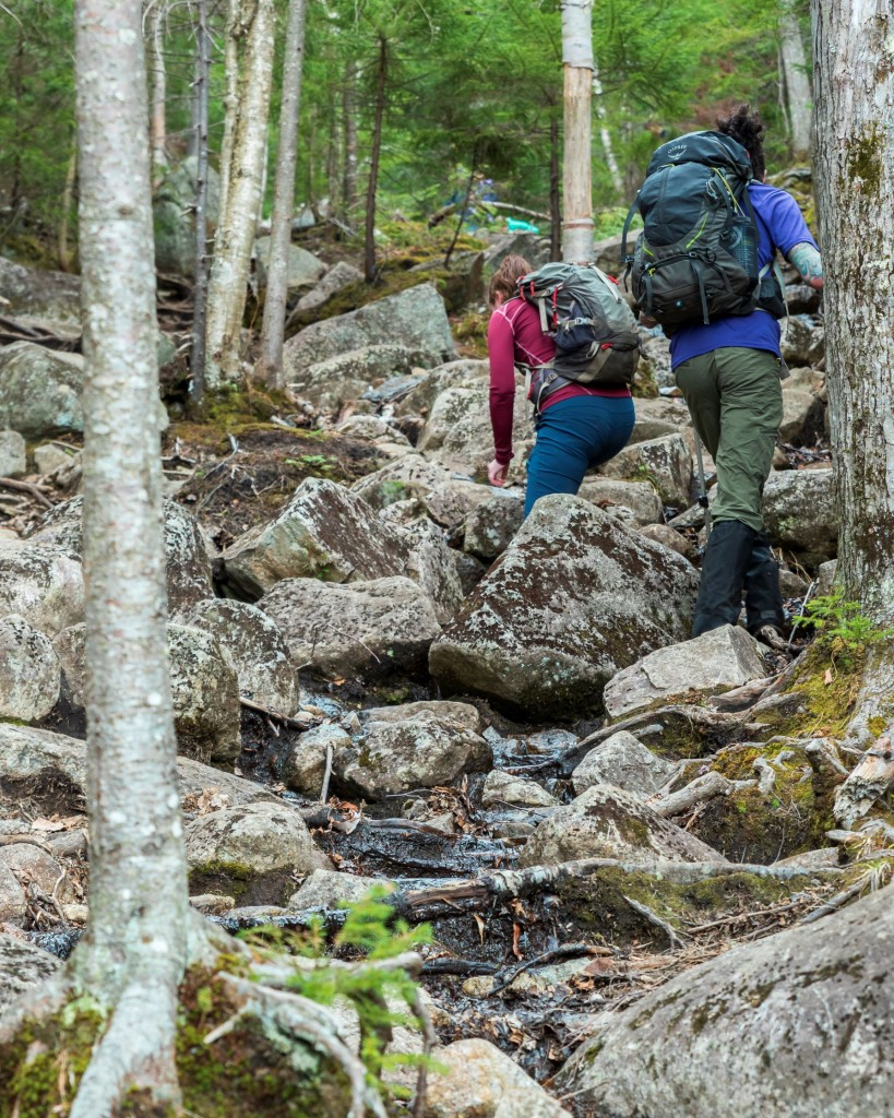 Hikers on an eroded trail