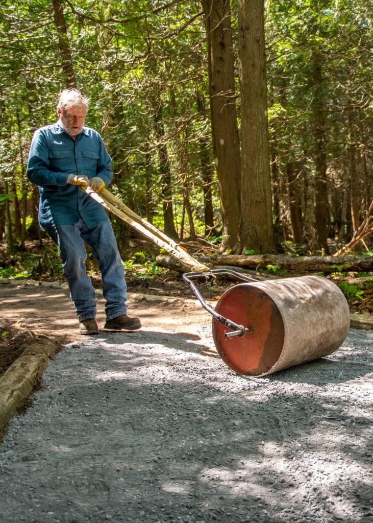 A man pulls an oil drum