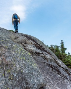A person hiking on a rock face