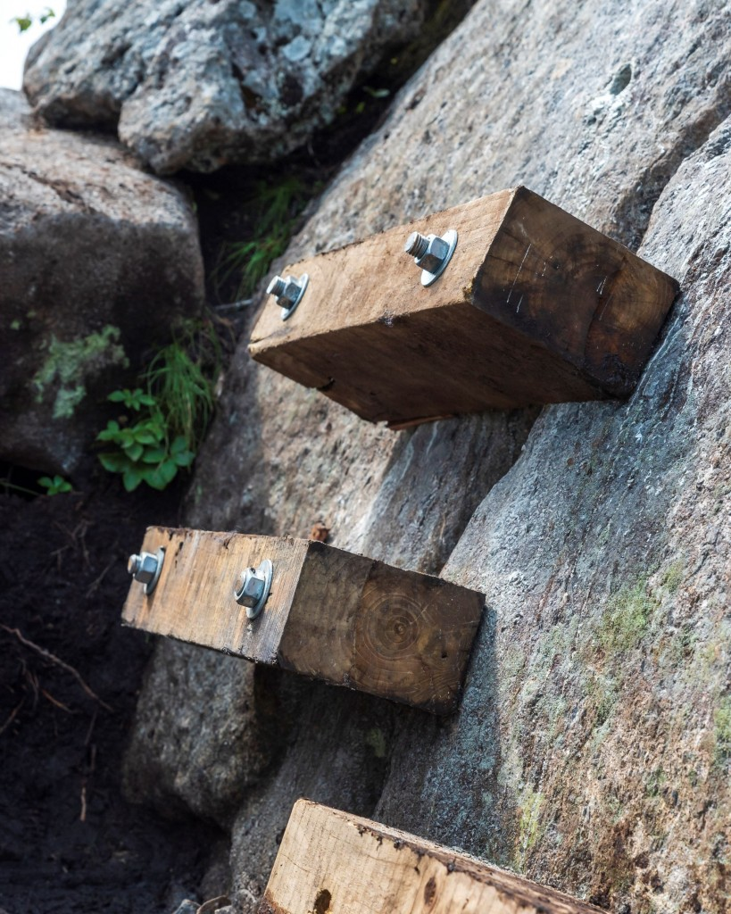Wooden stairs in a rock face