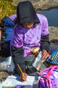 A child writes in a book